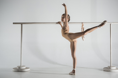 Photo for The girl is training near the ballet barre. - Royalty Free Image