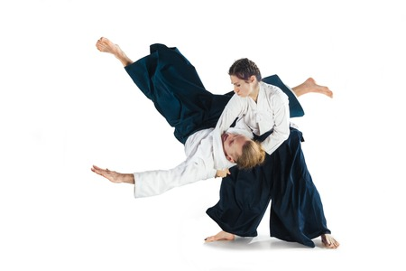 Foto de Man and woman fighting at Aikido training in martial arts school - Imagen libre de derechos