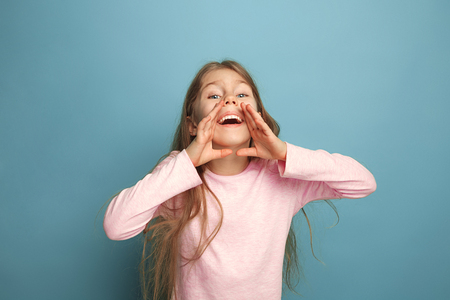 Photo for The emotional blonde teen girl have a happiness look and screaming. Studio shot - Royalty Free Image