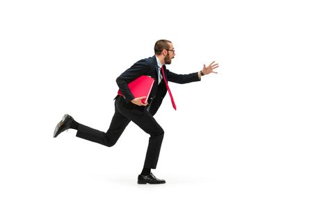 Photo pour Businessman running with a folder on white background - image libre de droit