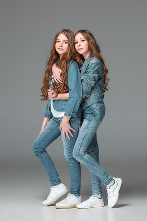 Photo for Full length of young slim female girl in denim jeans on gray background - Royalty Free Image