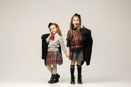 Photo pour The fashion portrait of young beautiful teen girls at studio - image libre de droit
