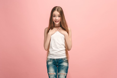 Photo for Beautiful teen girl looking suprised isolated on pink - Royalty Free Image