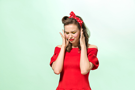 Photo pour Beautiful young woman with pinup make-up and hairstyle. Studio shot on white background - image libre de droit