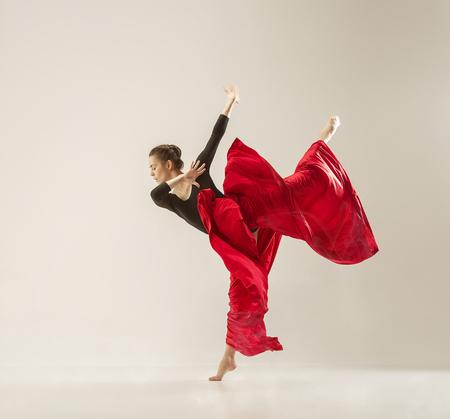 Foto de Modern ballet dancer dancing in full body on white studio background. - Imagen libre de derechos