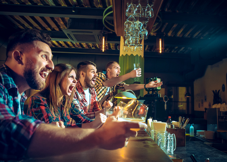 Photo for Sport, people, leisure, friendship and entertainment concept - happy football fans or male friends drinking beer and celebrating victory at bar or pub - Royalty Free Image