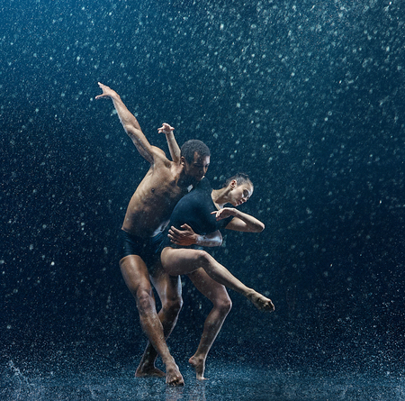 Photo for Young couple of ballet dancers dancing unde rwater drops - Royalty Free Image