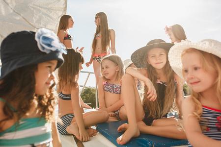 Photo pour The children on board of sea yacht - image libre de droit
