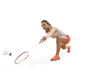 Photo for Young woman playing badminton over white background - Royalty Free Image