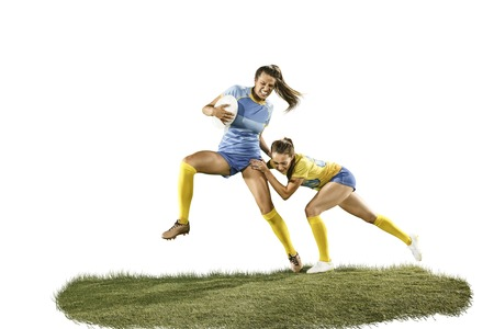 Foto de The young female rugby players isolated on white backround - Imagen libre de derechos
