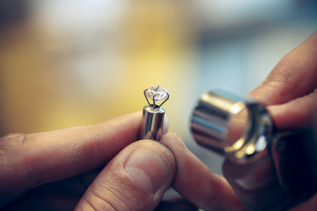 Photo pour Different goldsmiths tools on the jewelry workplace. Jeweler at work in jewelry. - image libre de droit