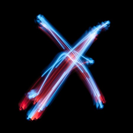 Photo for Letter X of the alphabet made from neon sign. The blue light image, long exposure with colored fairy lights, against a black background - Royalty Free Image