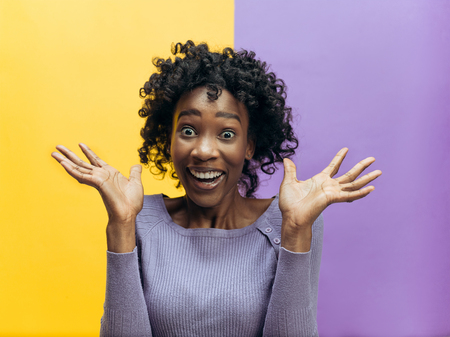 Photo for I won. Winning success happy woman celebrating being a winner. Dynamic image of african female model on studio background. Victory, delight concept. Human facial emotions concept. Trendy colors - Royalty Free Image