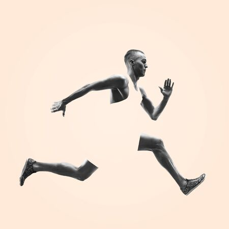 Photo pour Young caucasian man running isolated on studio background. One male runner or jogger. Healthy lifestyle, movement, action, motion, advertising and sports concept. Abstract design. - image libre de droit