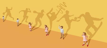 Photo for Childhood and dream concept. Conceptual image with children and shadow on the yellow studio wall. Little girl and boy want to become gymnast, dancer, artist, boxer, runner or football player. - Royalty Free Image