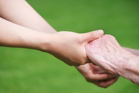 Photo for Senior and Young Women Holding Hands Outside - Royalty Free Image