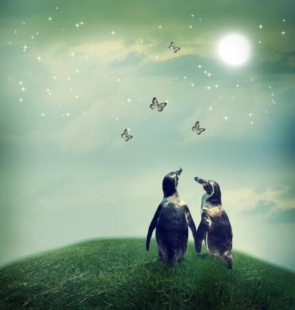 Foto de Two penguin friendship or love theme image at a fantasy landscape - Imagen libre de derechos