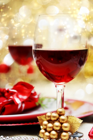 Photo for Decorated Christmas Dinner Table with Red Wine - Royalty Free Image