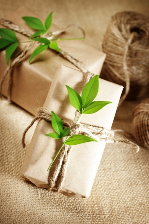 Photo for Natural style handcrafted gift boxes with rustic twine on burlap - Royalty Free Image