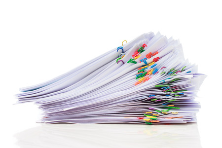 Photo pour Stack of documents with colorful clips  - image libre de droit