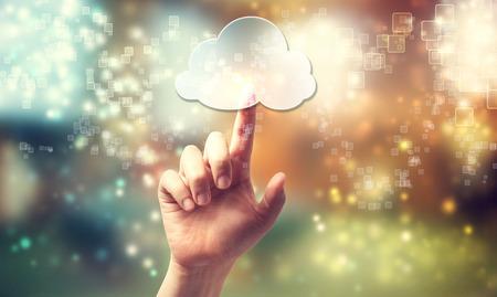 Photo pour Cloud computing symbol being pressed by a persons hand - image libre de droit