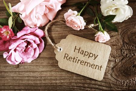 Foto de Happy retirement card with roses on rustic wooden board - Imagen libre de derechos
