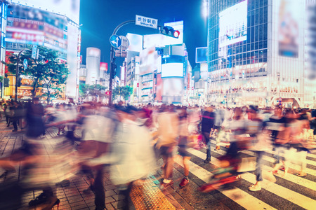 Photo pour People and vehicles cross the famously busy Shibuya station intersection in Tokyo - image libre de droit