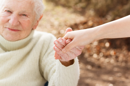 Photo for Elderly woman holding hands with young woman outside - Royalty Free Image