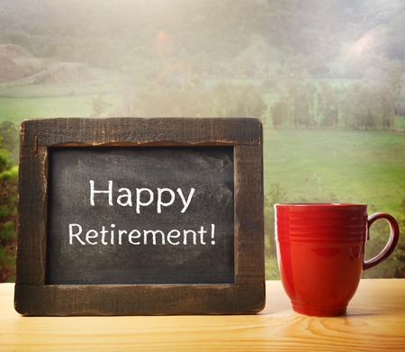 Foto de Happy retirement and relaxation theme with chalkboard text  - Imagen libre de derechos