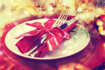 Foto de Red and gold themed holiday dinner table plate setting - Imagen libre de derechos