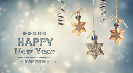 Photo for Happy New Year everyone text with hanging star ornaments - Royalty Free Image