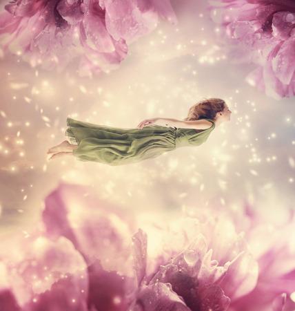 Foto de Beautiful young woman with giant peony flowers - Imagen libre de derechos