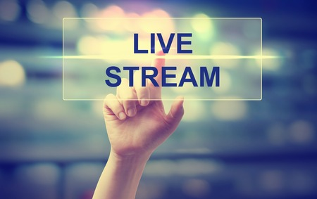 Photo for Hand pressing Live Stream on blurred cityscape background - Royalty Free Image