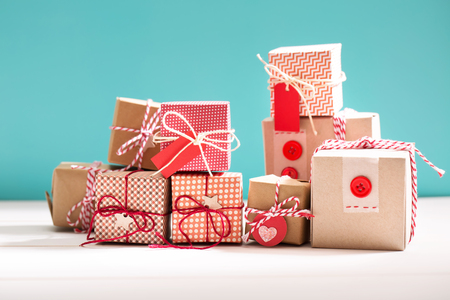Photo for Collection of little handmade gift boxes on blue background - Royalty Free Image
