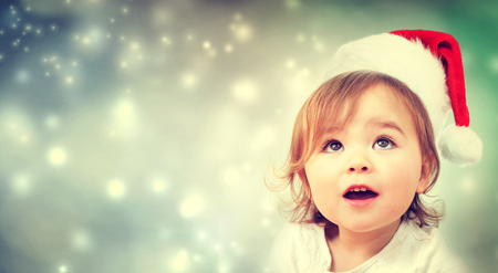 Photo for Happy Toddler girl with a Santa hat - Royalty Free Image
