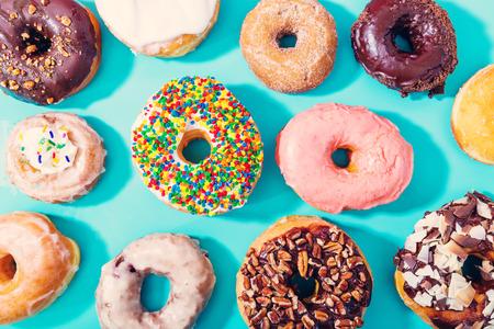 Photo pour Assorted donuts on a pastel blue background - image libre de droit
