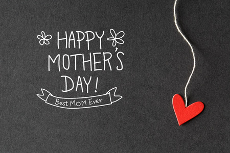 Photo pour Happy Mothers Day message with handmade small paper hearts - image libre de droit