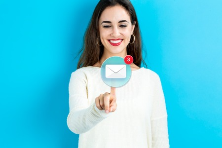 Photo pour Email icon with young woman on a blue background - image libre de droit