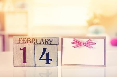 Foto de Valentines day theme with wooden block calendar - Imagen libre de derechos