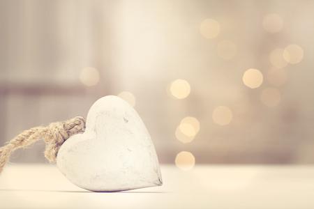 Photo pour White wooden heart on abstract light background - image libre de droit