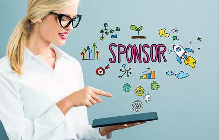 Photo pour Sponsor text with business woman using a tablet - image libre de droit