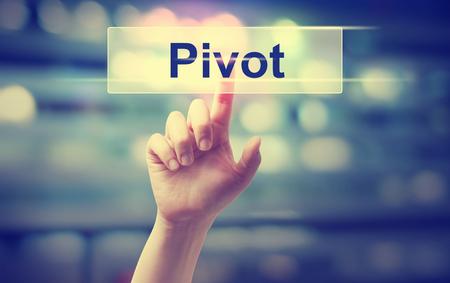 Foto de Pivot concept with hand pressing a button - Imagen libre de derechos