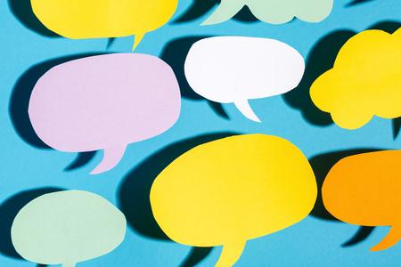 Photo pour Speech bubble text message theme with hard shadow on a blue background - image libre de droit