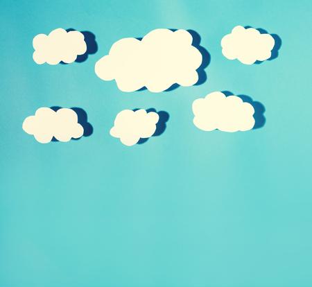 Photo pour Paper cloud with hard shadow on a blue background - image libre de droit