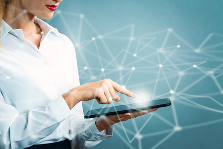 Foto de Young business woman using a tablet - Imagen libre de derechos