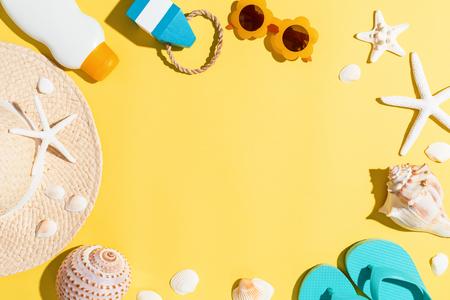 Foto de Summer lifestyle objects theme on a yellow background - Imagen libre de derechos