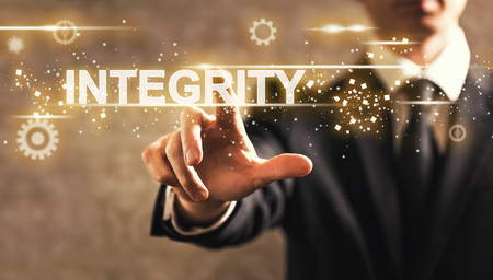 Photo for Integrity text with businessman on dark vintage background - Royalty Free Image