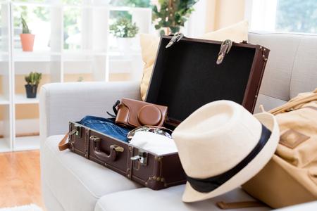 Foto de Packing a suitcase and backpack for a trip - Imagen libre de derechos