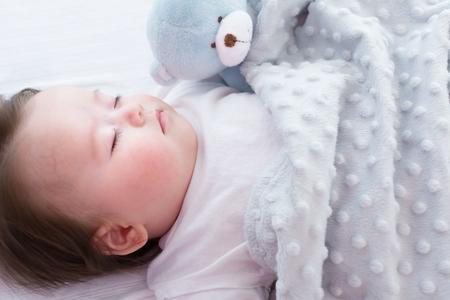 Photo pour Little baby boy sleeping in his house - image libre de droit