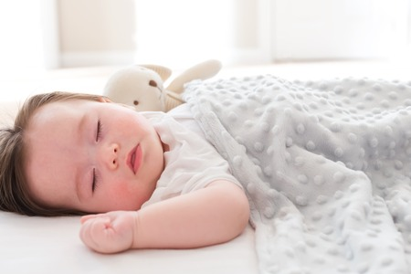 Photo pour Little baby boy sleeping in his house - image libre de droit